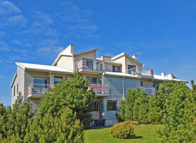 Vila Verbena Palangoje: 2-3 kambarių apartamentai su atskirais įėjimais, balkonu ar terasa, virtuve. 7min. iki jūros!