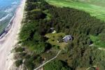 Hunters House Rent in Butinge by the sea, with a beach volleyball court.